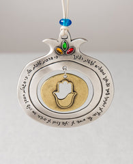"A richly designed pomegranate and Hamsa hanging ornament that is remarkably original and impressive. The ornament is coated in sterling silver. The frame of the pomegranate is hollow and has the appreciative words ""Since you have given much of your goodness to me..."" engraved on it. The words are taken from ""The Song of Yichud for Sunday"", which is sung at the morning prayer of every Sunday in which we thank God for everything which he has given us, praise him and commit to fulfill his commandments. The cro"