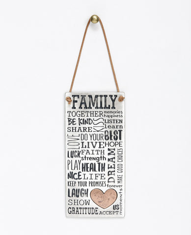 The beautiful words, charming blessings and enlightening expressions that turn any family into a united, happy, and loving one. A wonderful and special gift for your family or for the one you love. This rectangular wall pendant is modernly designed with a typographic engravement done by hand, coated in sterling silver and combined with a copper heart. Hangs from a natural colored faux leather string.  Length: 14 cm  Width: 6 cm
