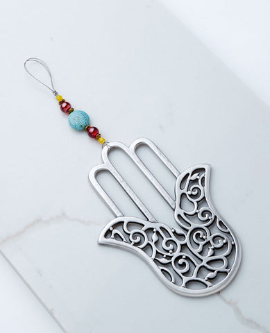 Azure hamsa plated in sterling silver.  Length: 22 cm  Width: 10 cm