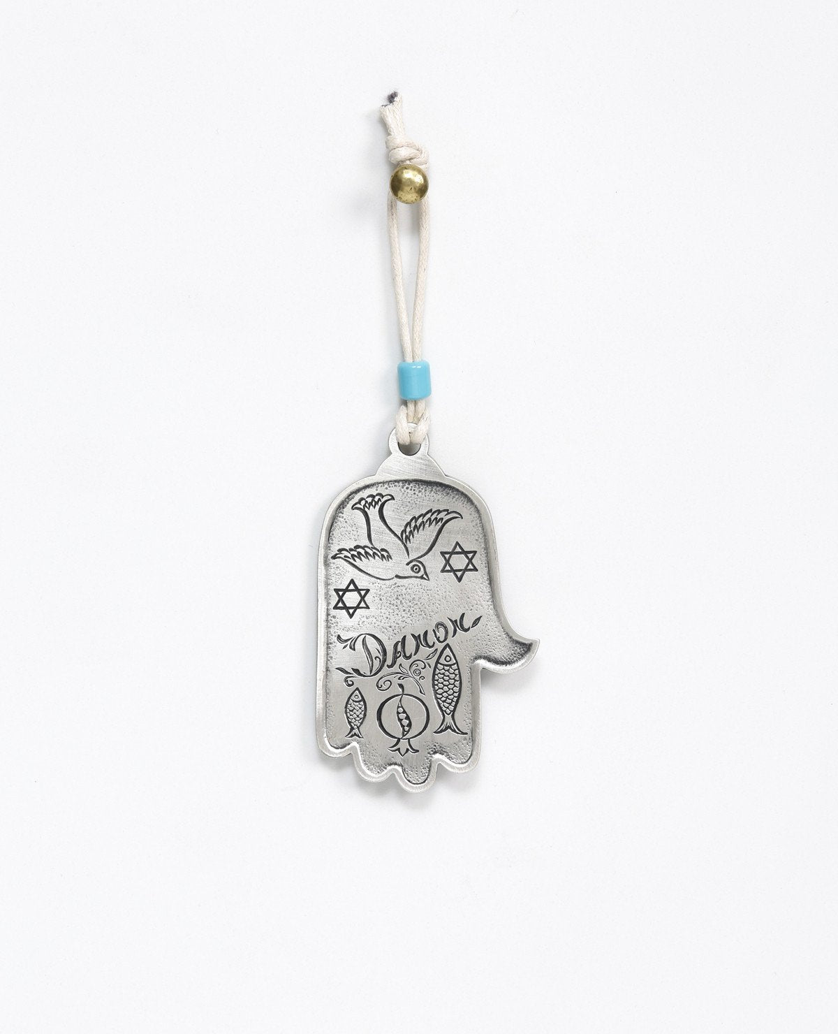 "A hanging Hamsa ornament decorated with a filigree engraving, coated in sterling silver and embedded with a turquoise colored stone. The Hamsa hangs from a leather string which is decorated by a turquoise colored bead. The Hamsa is a well known good luck charm that contains qualities that protect from the ""evil eye"". That's why it makes such a sweet and joyful gift to hang on the wall, the car mirror, and in any place where we ask to grant protection and a good blessing.  Length: 9 cm  Width: 5 cm"