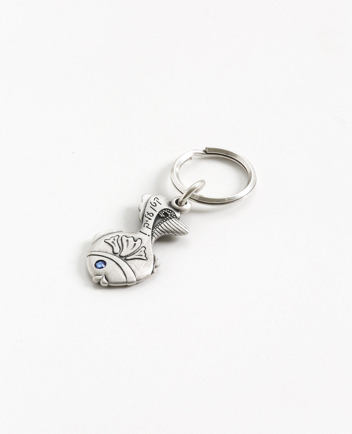 "A small fish keychain with the words ""easy for you!"". The word 'easy' is coated in sterling silver and embedded with a blue colored Swarovski crystal. The design is sweet and elegant, plus it's fun to pull out of your pocket with all your keys safely attached. Together with a loving smile, it makes a great gift to give to those that matter to us, in order to remind them how talented and capable they are in accomplishing anything they may choose. The luck is already inside.   Length: 5 cm  Width: 2 cm"