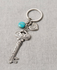 "Love is the key to everything! Always! A keychain that is all love. Designed as a large and impressive key decorated with embossed artistic elements and tiny hearts. On one side the sentence ""Love Is The Key"" is engraved, and on the other side the sentence ""The Key To My Heart"". Connected to the top of the key is a chain with a sweet heart and a beautiful turquoise stone hanging upon it. The keychain is coated in sterling silver and is strong and reliable. An exciting gift for those still searching for the"