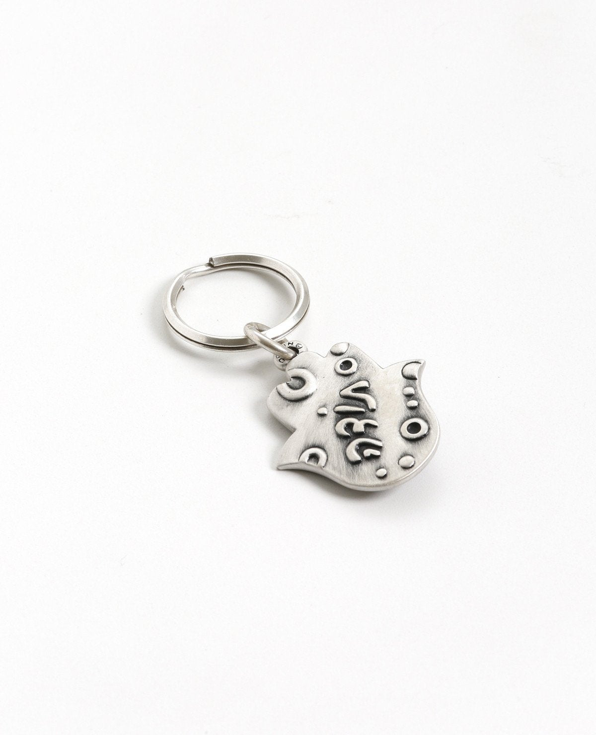 "Just to say ""Thanks"". A charming keychain designed in the shape of a Hamsa, with one word that says it all. On one side of the Hamsa is an eye embedded with a turquoise colored stone, and on the other side the word ""Thanks"" is embossed. The keychain is coated in sterling silver and is strong and reliable. Did you want to say thanks in a bit of a different way and combine it with the Hamsa's blessing against the ""evil eye""? You got it!  Length: 4 cm  Width: 3 cm"