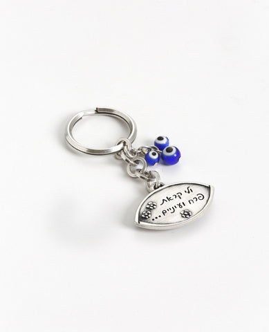 """Flower"" and ""eyes"" are loving nicknames in Hebrew. Now it will be with you all the time and open doors in your life. A sweet and charming keychain coated in sterling silver and decorated with an abundance of blue eyes for protection from any ""evil eye"". On one side of the keychain is an embossed image of an eye embedded with a blue eye, and engraved on the other side is the sentence ""...and you called me flower and eyes..."" decorated with cute little flowers. Three more blue eyes hang from a chain that is"