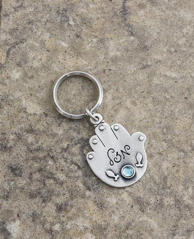 Sterling silver plated key ring with a Swarovsky crystal.  Length: 8 cm  Width: 4 cm