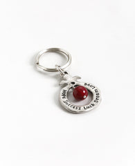 Always bless! A charming keychain, designed as a hollow pomegranate with a big red bead in the center. Written on one side are many blessings in Hebrew, and on the other side many blessings in English. The keychain is coated in sterling silver and is strong and reliable.  Makes for quite the useful gift that is also festive and very blessed, suitable for both Hebrew and English speakers, near or far, in Israel and abroad.  Comes also in your choice of turquiose colored bead.   Length: 8 cm  Width: 4 cm