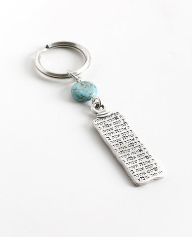 "A classically designed keychain - for him or for her. Shaped like an elongated rectangle with the words ""Everything is Possible!"". Written on the other side are empowering words of hope and inspiration. A rounded turquoise bead at the top of the keychain completes the classic look. The keychain is coated in sterling silver and is strong and reliable. A gift that is always appropriate to give to a special person, in any opportunity, to remind that when you want something and believe - everything is possible!"