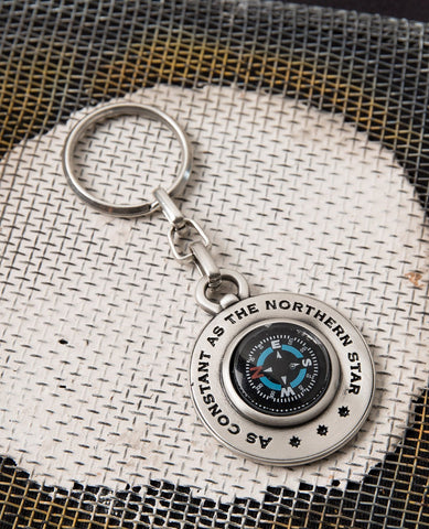 "An intriguingly designed and one of a kind keychain. One side is a (real) compass encircled by the words ""As constant as the northern star"". On the other side is an ancient drawing of the map of the world. The keychain is coated in sterling silver and is strong and reliable. A charming and useful gift that will always remind its owner that North is always there and all you have to do is find it. Compass is already inside.    Length: 9 cm  Width: 4 cm"