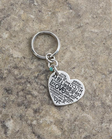 "As romantic as it gets! For him and for her. A charming keychain in the shape of a decorated heart with the words ""I love you just the way you are"" written on one side. On the other side the word ""Love"" is written in different languages. At the top of the heart hangs a small turquoise colored bead. The keychain is coated in sterling silver and is strong and reliable. Can you think of anything more romantic to give to him or her? Is there anything beyond accepting our loved ones exactly as they are?  Comes a"