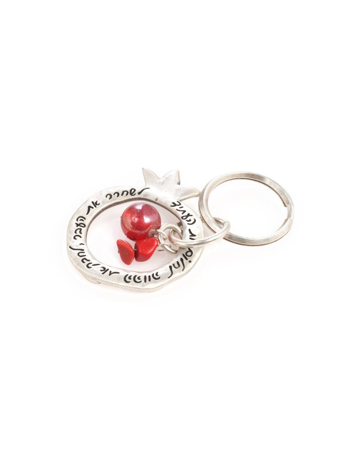 "A charming keychain with an important message for life. The keychain is designed as a hollow pomegranate coated in sterling silver. At its center hang a red bead and two beautiful red stones. Written on one side of the pomegranate frame are the words ""Let go of the past, embrace the present, dream the future"". On the other side of the frame are little pomegranate decorations. The keychain is strong and reliable. A wonderful and exciting gift for him or for her, or for anyone in fact who wants to live life a"