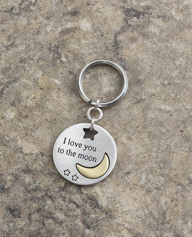 "A charming keychain that comes with great love! Designed in the shape of a circle with one side having an imprinted image of a brass colored moon with the words ""Love you to the moon"" written on it. On the other side the words ""and back"" are written on a silver coated moon.  Two small stars decorate each side of the circle. The keychain is coated in sterling silver and is strong and reliable.  Makes a great gift for her, him, children and parents, best friends - when we wish to express the great love we hav"