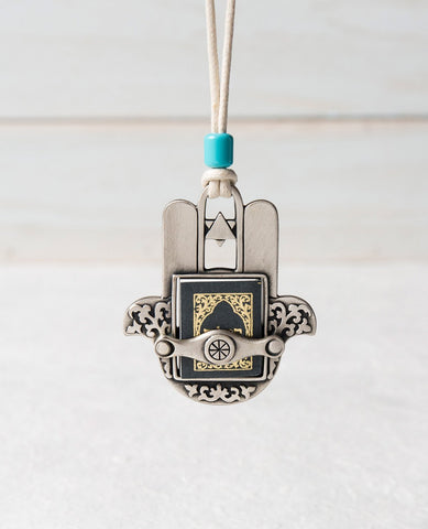 Sterling silver plated car pendant with a turquoise bead.  Length: 7 cm  Width: 6 cm