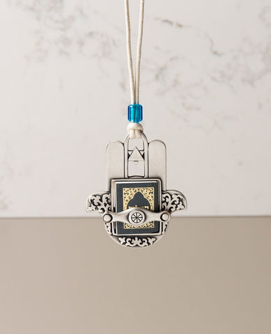 Sterling silver plated car pendant with a blue bead.  Length: 7 cm  Width: 6 cm