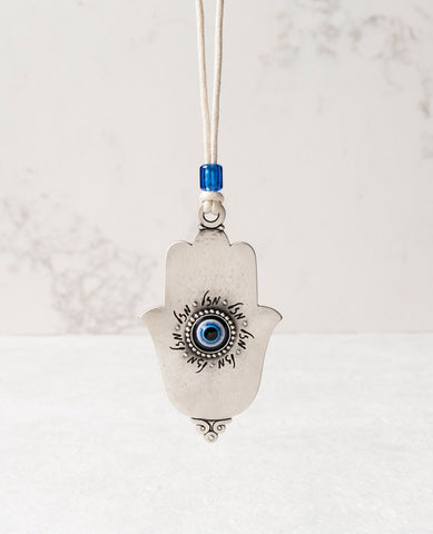 Sterling silver plated car pendant with a blue bead.  Length: 9 cm  Width: 5 cm