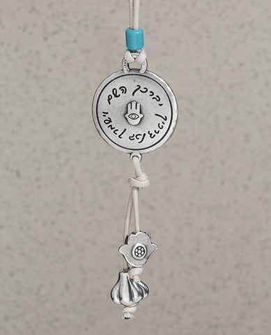 Sterling silver and brass plated car pendant with a blue bead.  Length: 12 cm  Width: 4 cm