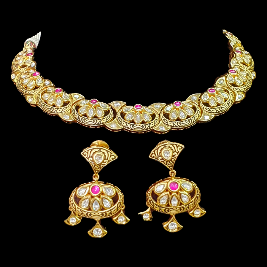 Gold Plated Necklace Set Studded with Fine Gold Carvings and Pink Stones (BANS0099)