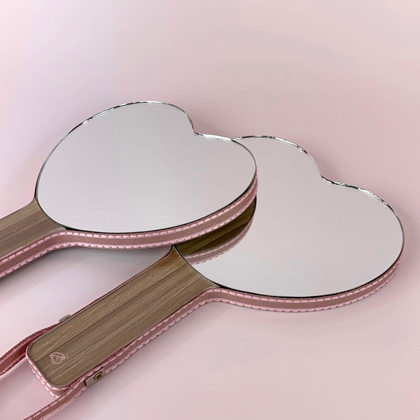 Hand held heart shaped glossy pops mirror