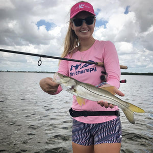 Pink performance fishing shirt and a Florida snook