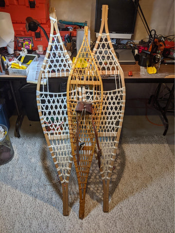At 68 years, I am finally finishing a second pair of Large Ojibwa Snowshoes. 35+ years ago bought from another builder in Minneapolis-  Larson and Larson outdoor design.   I had a medium set I built 40 plus years ago and snowshoed Yellowstone from the south gate to Old Faithful.   Here is a picture of the two different sets.