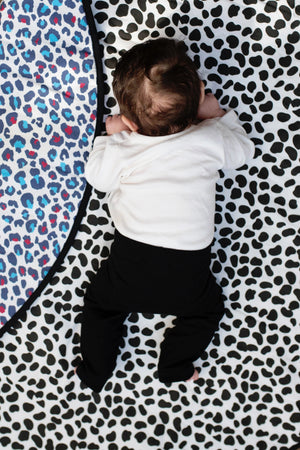Reversible sensory playmat