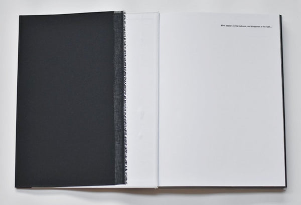 Photo book: What appears in the darkness, and disappears in the light...