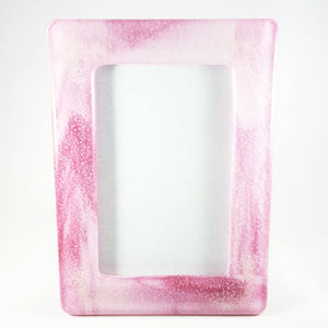Picture frame - Pink and white swirled glass with cremation ash in each corner.