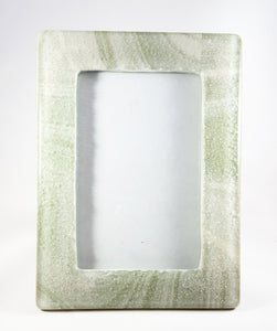 Picture frame - Green and ivory swirled glass with cremation ash in each corner.