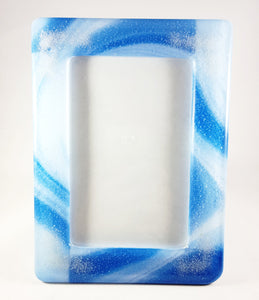 Picture frame - Blue and white swirled glass with cremation ash in each corner.