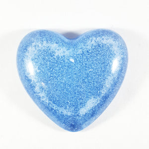 Heart paperweight - Light sapphire glass heart with cremation ash inside