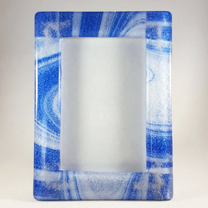 Picture frame - Medium blue and opal swirled glass with cremation ash in each corner.