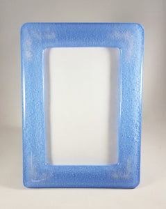 Picture frame - Shimmery hyacinth glass with cremation ash in each corner.