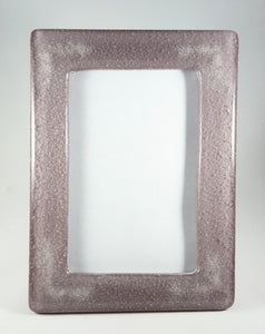 Picture frame - Shimmery lilac glass with cremation ash in each corner.