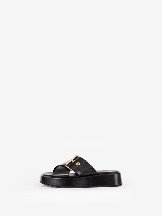 "Black chunky ""DETOX"" flatform sandal from Swedish premium shoe brand ANNY NORD with heavy gold trims for an everyday splash of luxe."