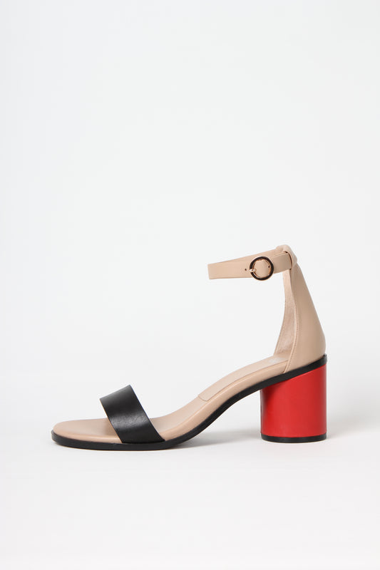 ANNY NORD sandal, style name 24-7, beige, combination of beige, black and poppy red leathers. Round gold meteal buckle and cylinder shaped heel. Sideview photo.