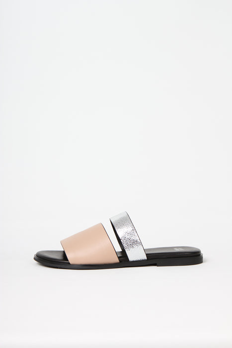 BUSY DOING NOTHING is a comfortable luxury slide sandal in pale nude and silver leather from Swedish shoe and accessory brand ANNY NORD