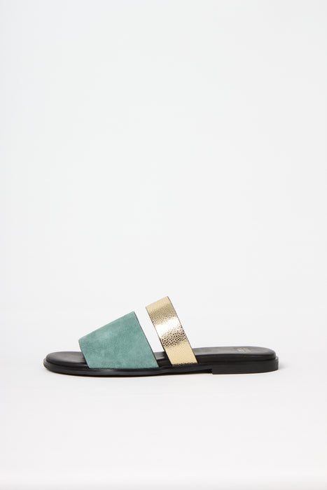 BUSY DOING NOTHING is a comfortable luxury slide sandal in dusty green kid suede and gold leather from Swedish shoe and accessory brand ANNY NORD
