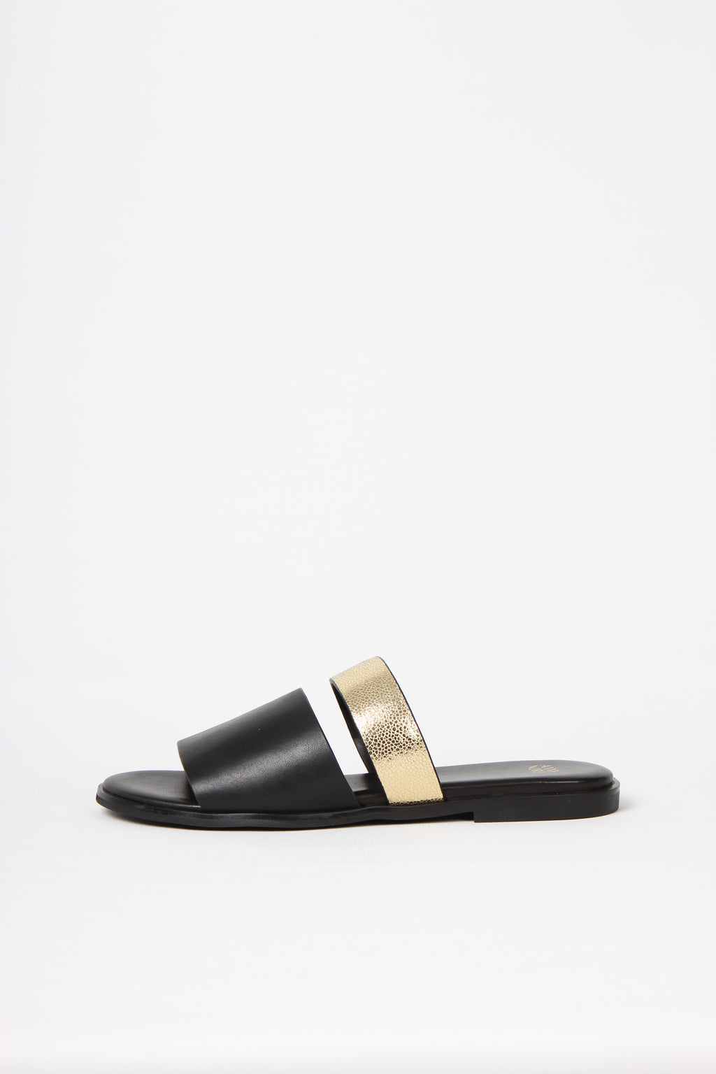 BUSY DOING NOTHING is a comfortable luxury slide sandal in black and gold leather from Swedish shoe and accessory brand ANNY NORD
