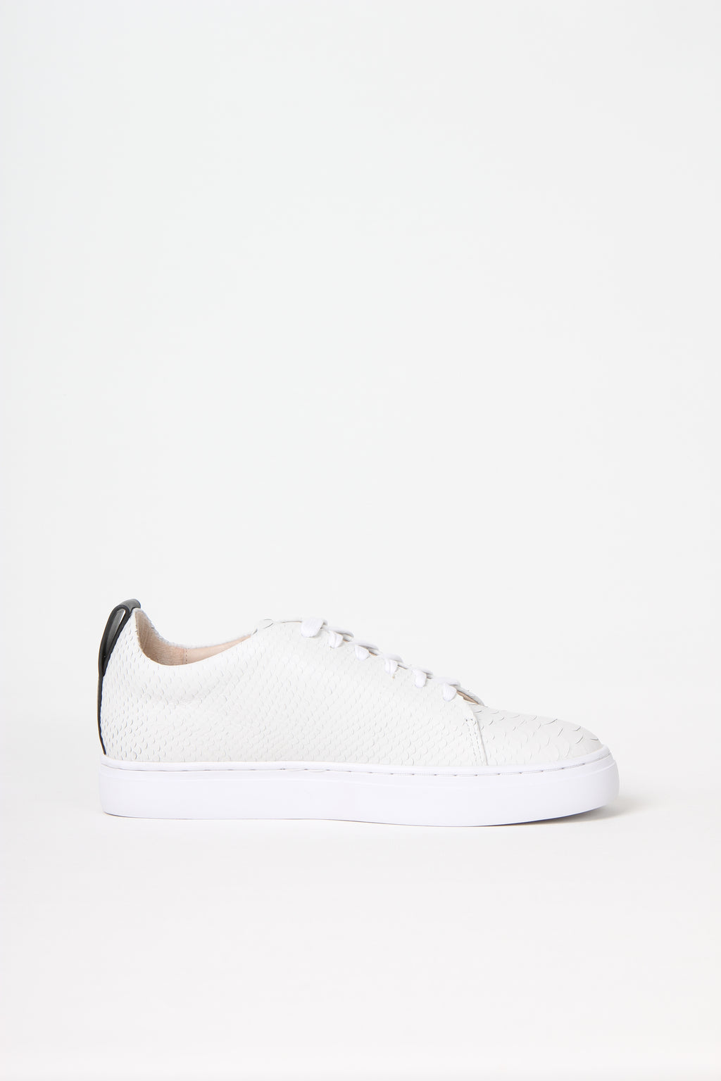 Premium lace up sneakers in off-white snake embossed calf leather from Swedish shoe brand ANNY NORD.
