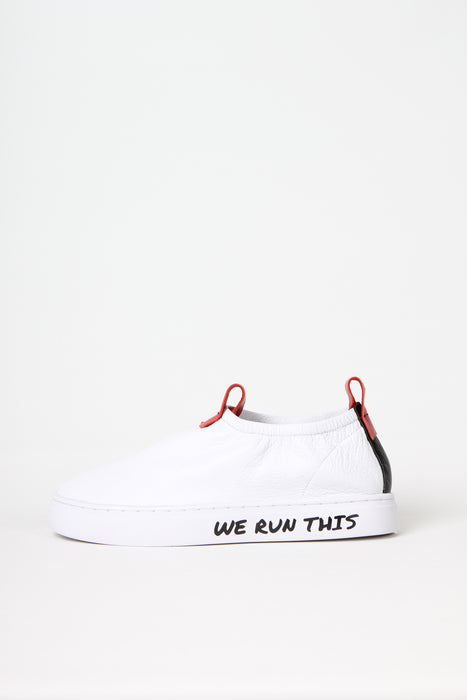 WE RUN THIS - White deconstructed super soft slip-on sneaker in napa leather. All profits from this shoe will be donated Women's rights organization Kvinna till Kvinna to support them in their fight for women's equal rights.
