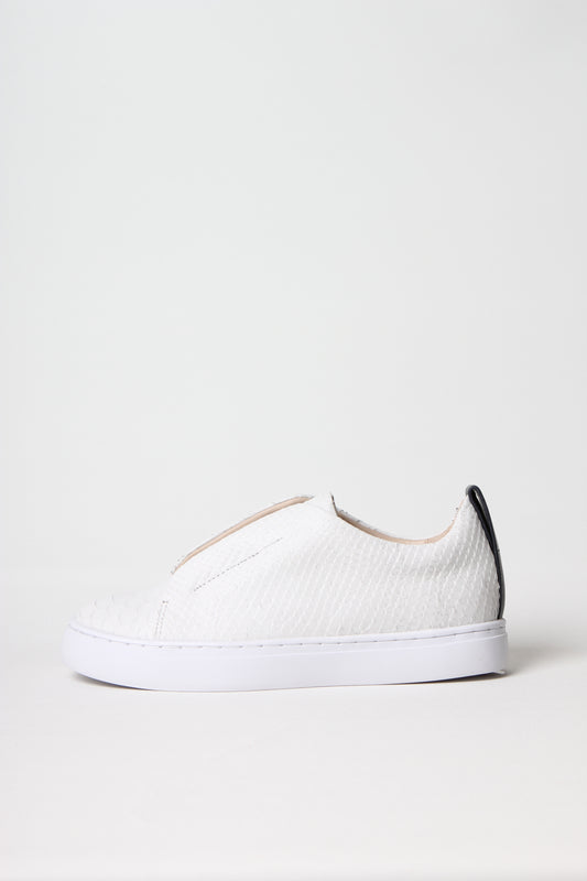 Premium slip-on sneaker in off-white snake embossed calf leather from Swedish shoe brand ANNY NORD.