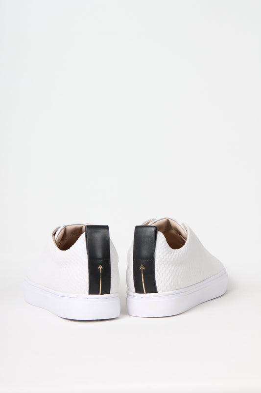 Premium slip-on sneakers in off-white snake embossed calf leather from Swedish shoe brand ANNY NORD.