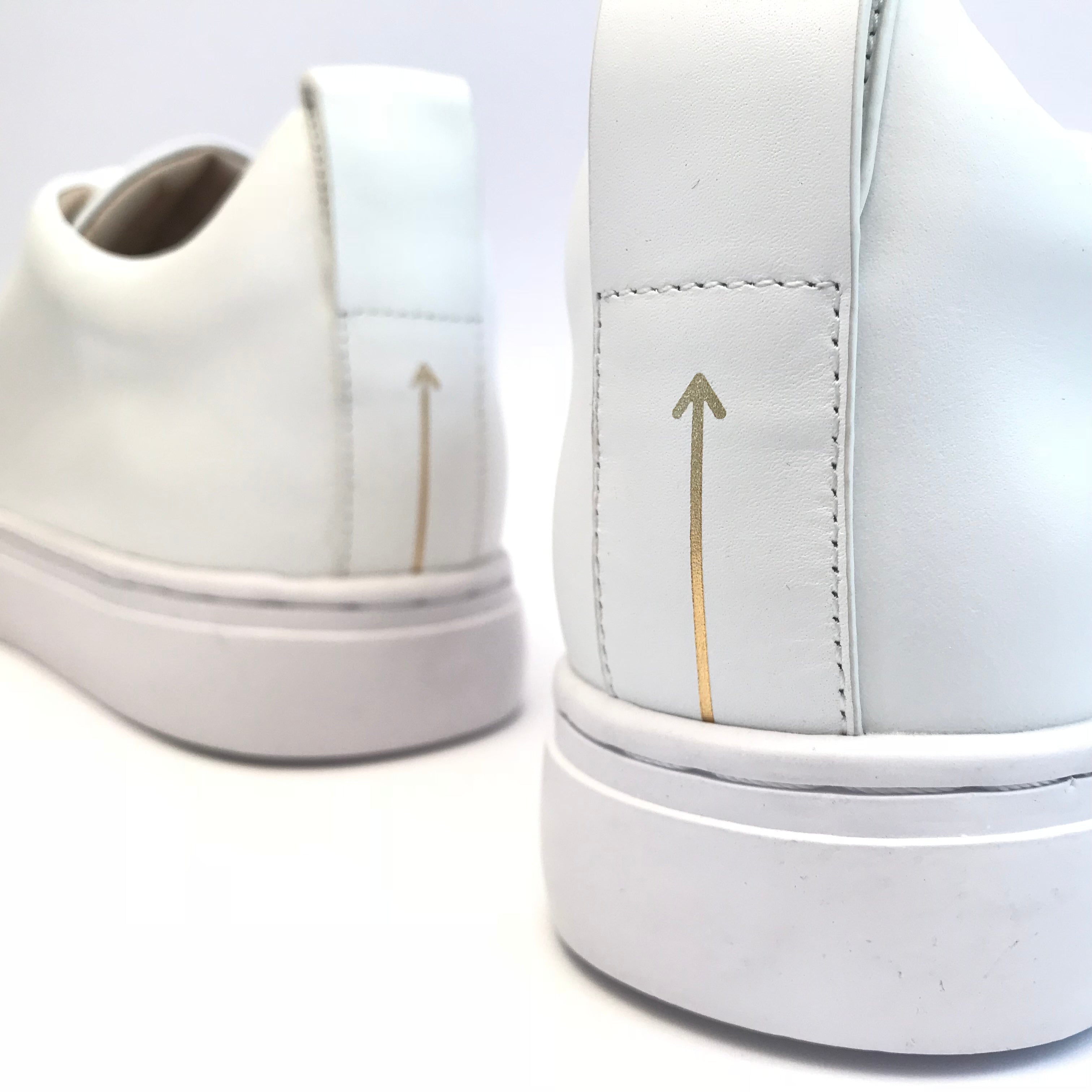 Minimalist lace up sneaker from Swedish shoe brand ANNY NORD with signature gold arrow on back puller.