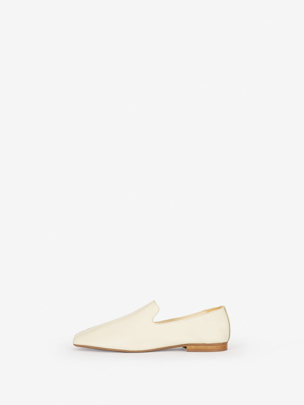 Comfy and chic loafer with a super soft decnstructed construction vanilla colorway viewed from side