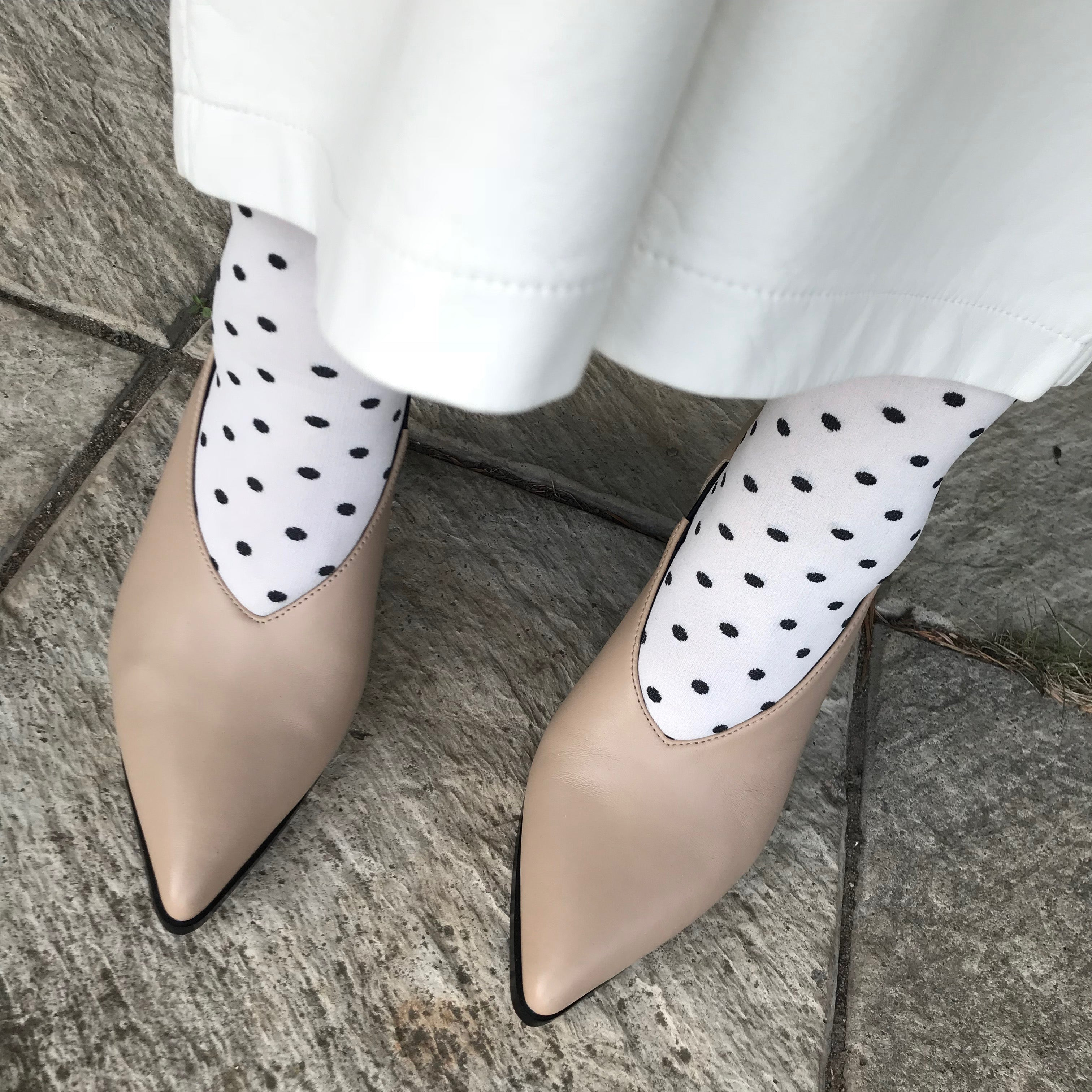 Roach Killer V-cut pump from Swedish shoe brand ANNY NORD.  A classic shoe with a modern twist. Here styled with polka dotted socks and leather skirt.