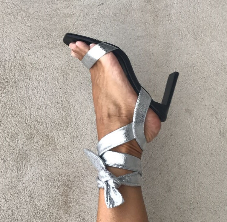Wrap tie, party sandal in super soft silver metallic leather from Swedish shoe brand ANNY NORD. Heel height 80 mm.