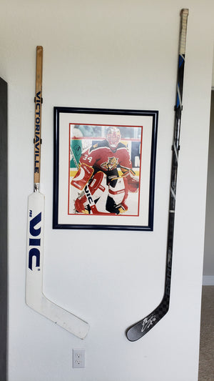Goalie stick mounted on wall