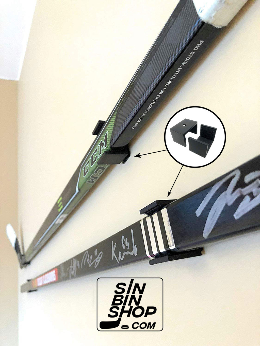 Hockey stick wall display bracket