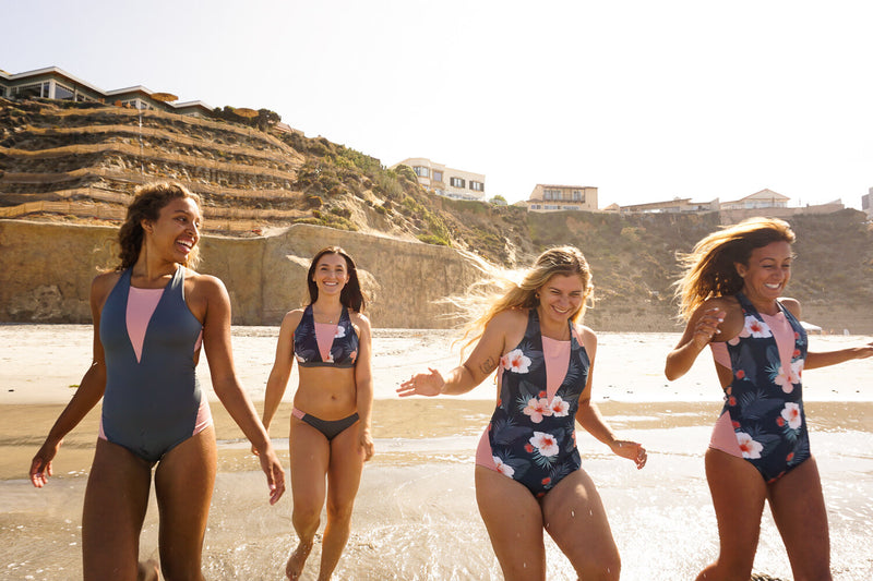 Girls Running on the Beach in Hakuna Wear's Active Swimwear for Surfers