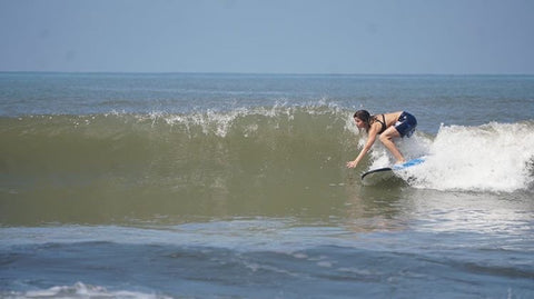 surfing woman in goa