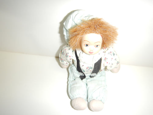 Antique Doll With Green Pants